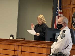 Judge McLaughlin hold up right hand